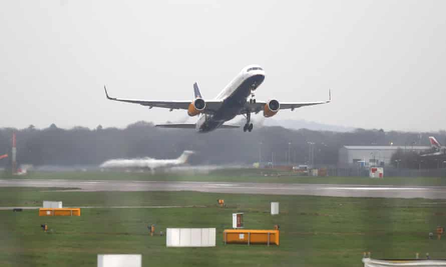An aircraft takes off from Gatwick Airport, where a British Muslim family was denied permission to travel to Los Angeles earlier this month.