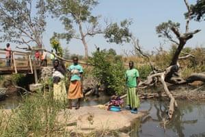 Women stand between the borders of Uganda and South Sudan near Bibi bidi, Uganda.