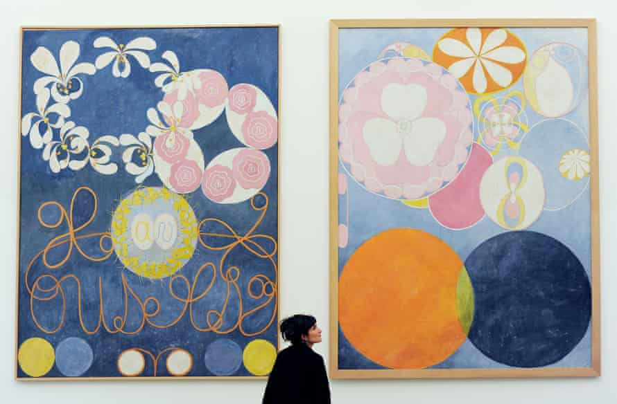 A woman views Hilma af Klint's Group IV, The Ten Largest, 1907 at the Serpentine Gallery, London.