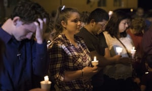 Mourners participate in a candlelight vigil held for the victims of a fatal shooting at the First Baptist Church of Sutherland Springs.