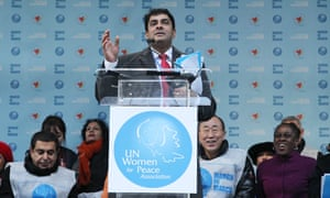 Ravi Karkara speaks before a march for gender equality and women's rights on International Women's Day 2015
