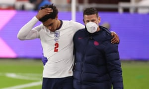 England v Austria - International Friendly<br>MIDDLESBROUGH, ENGLAND - JUNE 02: Trent Alexander-Arnold of England receives medical attention from England Physio Simon Spencer during the international friendly match between England and Austria at Riverside Stadium on June 02, 2021 in Middlesbrough, England. (Photo by Eddie Keogh - The FA/The FA via Getty Images)