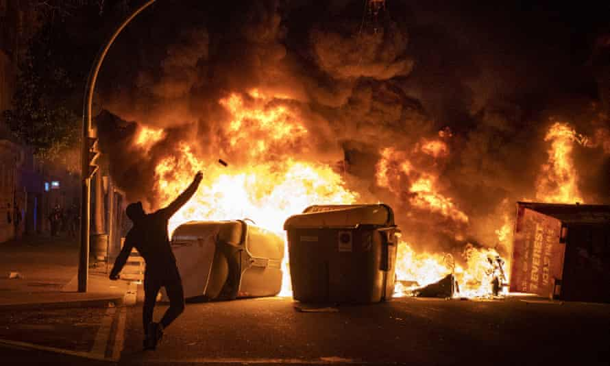 A burning barricade amid the third night of street protests in Barcelona and other Spanish cities over the jailing of Pablo Hasél.