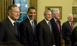 President George W Bush (C) welcomes (from L to R) his father, president-elect Barack Obama, and former presidents Bill Clinton and Jimmy Carter to the Oval Office on 7 January 2009.