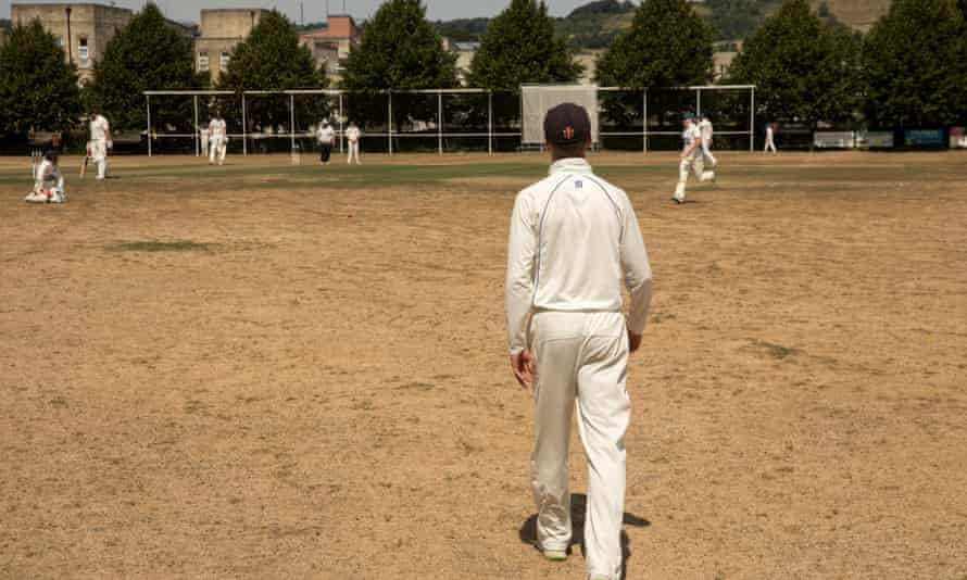 Players on a parched field at Lansdown Cricket Club in Bath.