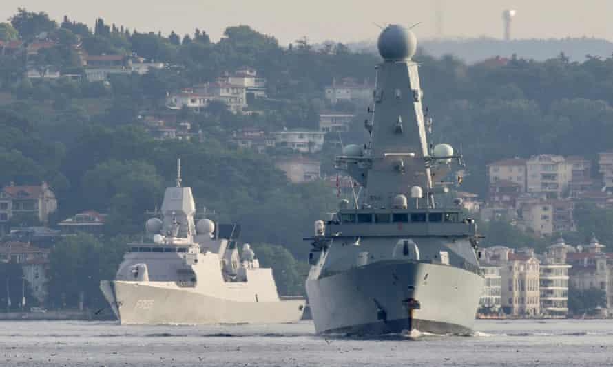 HMS Defender (right) sails in Istanbul's Bosphorus