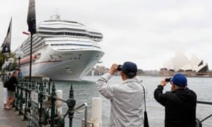 Tourists take photos along the Sydney Harbour