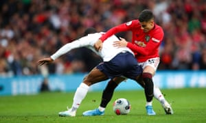 Andreas Pereira of Manchester United gets stuck in as he attempts to dispossess Liverpool's Georginio Wijnaldum.