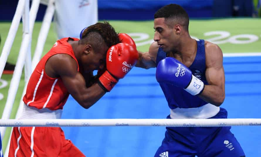 Britain's light-flyweight Galal Yafai, right, puts the pressure on Joahnys Argilagos of Cuba in their bout at the Rio Olympics.