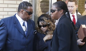 Tyka Nelson, center, the sister of Prince, is escorted by unidentified people as she leaves the Carver County courthouse on Monday.