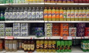 Bottles of sugary drinks on a shop shelf
