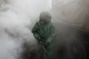 Saint Petersburg, Russia An army serviceman wearing protective gear sprays disinfectant as he sanitises a factory