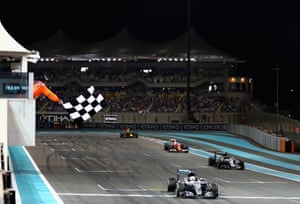 Hamilton takes the chequered flag, with Rosberg second.