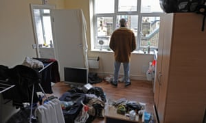 'Disgusting' … Ian Ford in his tiny flat which is covered in dark mould.
