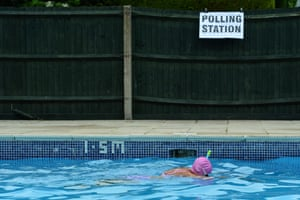 Voter Mrs Anne Whitman swims at Arundel Lido, set up as a polling station, in Arundel