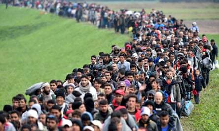 'The traumatic look on their faces comes from being kettled' … refugees cross from Croatia into Slovenia in October 2015.
