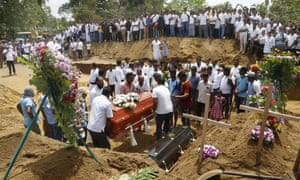Relatives and friends bury the victims of a series of bomb blasts at cemetery Don David Katuwapitiya in Colombo, Sri Lanka, 23 April 2019.