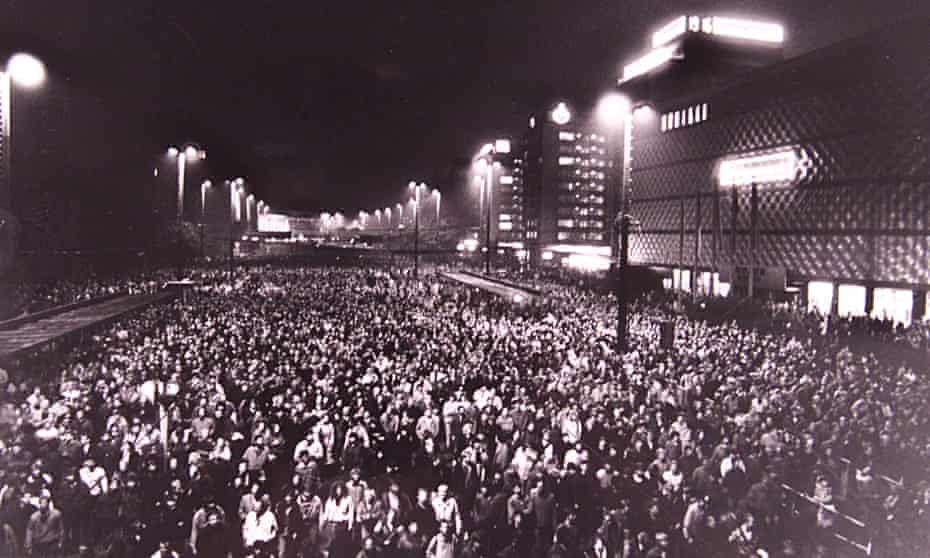 About 70,000 people walk through the city centre of the former East German town of Leipzig during a public protest, 9 October 1989.