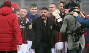Milan coach Gennaro Gattuso celebrates with his players after the match.