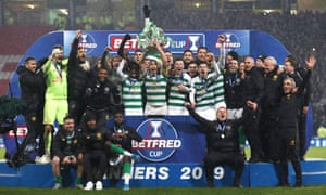 Scott Brown lifts the Betfred Cup with his teammates.