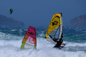 Windsurfers in heavy waves take advantage of the strong winds blowing at the Plage du David beach in Marseille, as a storm hits southern parts of France