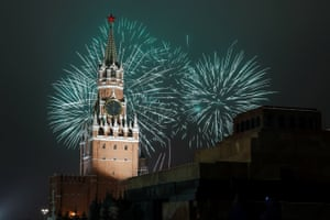 Fireworks explode behind the Kremlin's Spasskaya tower in Moscow, Russia