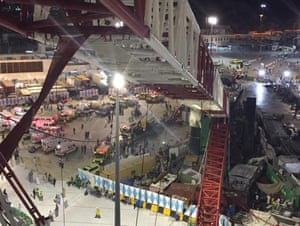 A collapsed crane and emergency services vehicles are seen near the Grand Mosque in Mecca.