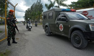 An Indonesian military ambulance evacuates the body of a soldier killed in Nduga