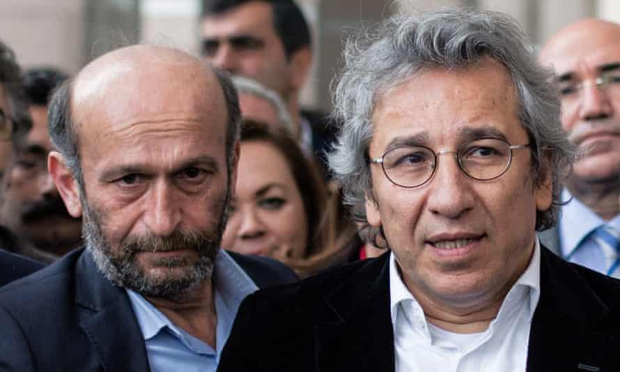 Can Dundar, editor-in-chief of opposition newspaper Cumhuriyet, right, and Ankara bureau chief Erdem Gul outside court on Thursday.