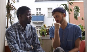 Jonas Kakoschke (right) and Bakary Conan chat at Kakoschke's flat in Berlin. Kakoschke gave shelter to Conan with his initiative Refugees Welcome, which has now placed 26 refugees in private homes.