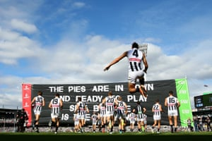 Brodie Grundy and his Collingwood teammates run through the banner before facing West Coast in round six.