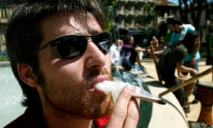A cannabis smoker in Porto, Portugal, during a march in favour of legalising drugs