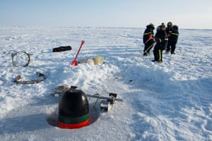 Civilian personnel from the US Navy's Arctic Submarine Laboratory prepare to retrieve a torpedo fired under the ice by the USS Hartford, a nuclear attack submarine, during ice operations. Two other submarines, including a Royal Navy submarine from the United Kingdom, later sailed below the ice to the North Pole from a base set up on a floating ice sheet 150 miles north of Deadhorse, Alaska.