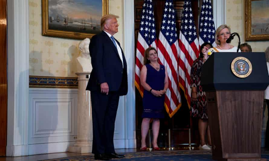 Donald Trump listens as Cleta Mitchell speaks at the White House on 18 August 2020.