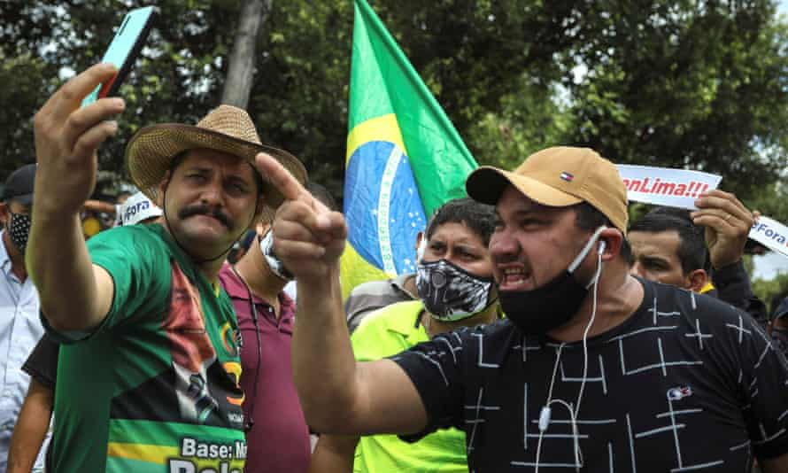 Supporters of the far-right president, Jair Bolsonaro, protest against the recommendations for social isolation of the governor of Amazonas Manaus on 19 April.