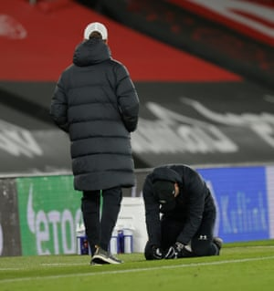 Southampton's Austrian manager Ralph Hasenhuttl (C) sinks to his knees.