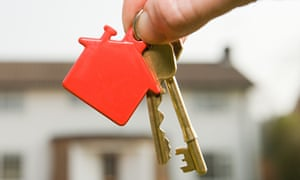 Person Holding House Keys