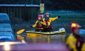 Rescuers look for stranded residents in flood-stricken Egypt Street, Pontypridd.
