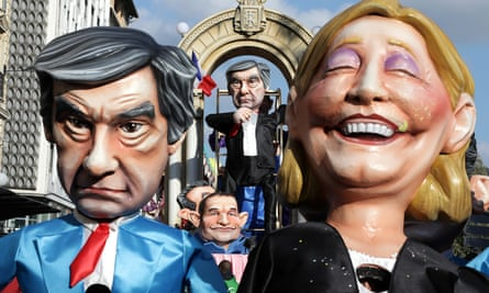 Figures of François Fillon, Marine Le Pen and other presidential candidates on show during the Carnival parade in Nice.