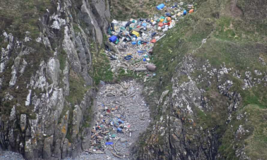 Litter washed up on a rocky Scottish coastline