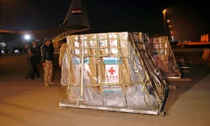 Air freight workers unload the first batch of doses of the Sinopharm vaccine against the coronavirus disease after it arrived at Baghdad international airport, in Baghdad, Iraq, early today