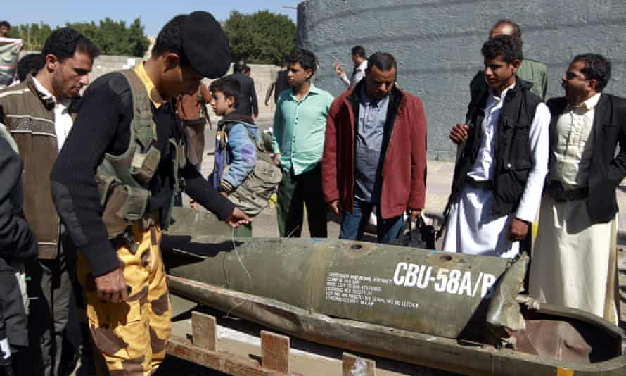 Yemenis in the capital, Sana'a, gather around the remains of what appears to a US-cluster bomb during a protest calling for an end to military operations by the Saudi-led coalition on Yemen.