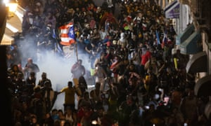 Police clash with protesters in front of the governor's mansion in San Juan, Puerto Rico's capital