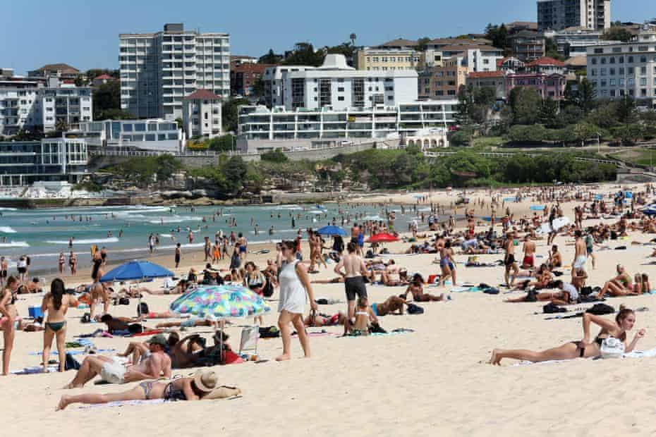 Beachgoers are seen at Bondi Beach despite the threat of Coronavirus (COVID-19) in Sydney, Friday, March 20, 2020.
