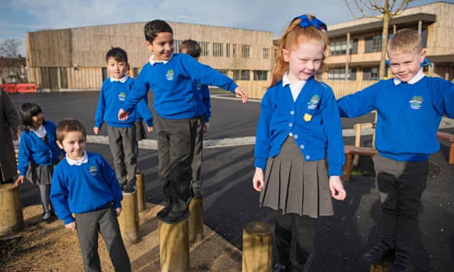 Hackbridge primary children and their new building
