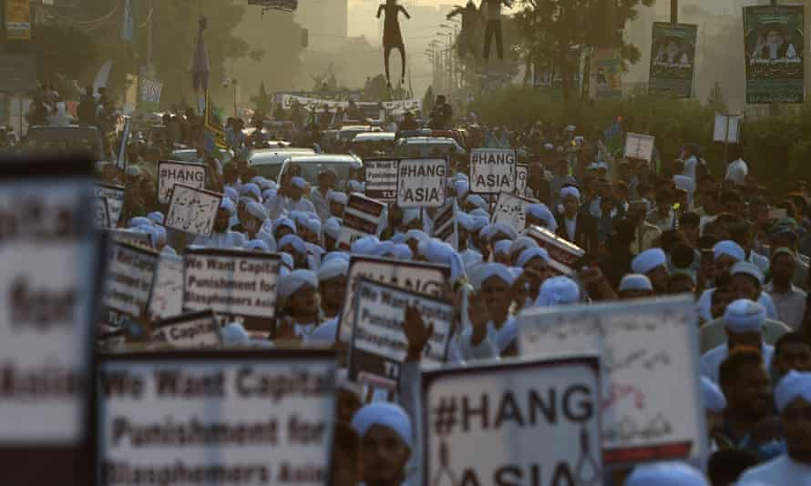Islamist activists carry placards against Asia Bibi, a Pakistani Christian woman