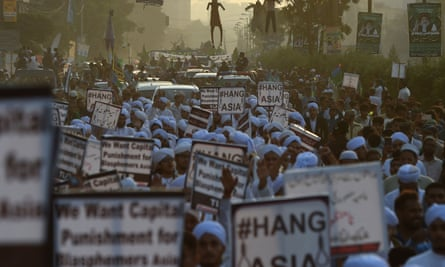 Islamist activists carry placards against Asia Bibi, a Pakistani Christian woman