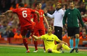 Roberto Soldado grabs the ankle of Dejan Lovren.