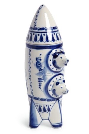 A hand-painted Gzhel porcelain decanter depicts Belka and Strelka peering from their rocket portholes.