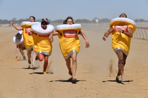 Runners dressed as glasses of beer compete in the Schooner Cup